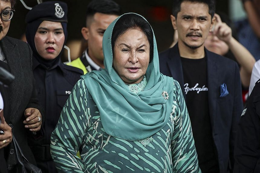 Rosmah Mansor, the wife of former Malaysian prime minister Najib Razak, leaving the Kuala Lumpur High Court yesterday. She is accused of receiving a RM5 million (S$1.7 million) bribe relating to a solar power project. PHOTO: EPA-EFE