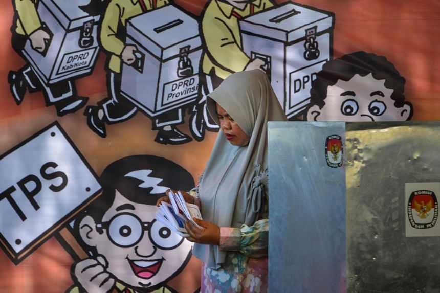 A woman checking her ballot papers during a pre-election drill at Banda Aceh, Aceh province, Indonesia, on April 6, 2019.