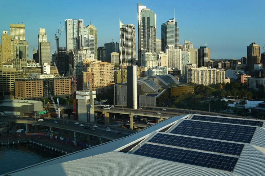 Solar panels on the rooftop of the International Convention Centre in Sydney. Since 2006, Sydney has reduced its electricity consumption by around 26 per cent.