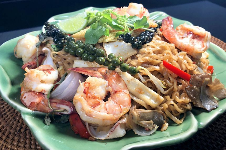 Pad Kee Mao (Drunkard's Noodle) is a Thai-style dish of fried noodles with an assortment of ingredients such as seafood and green peppercorns.