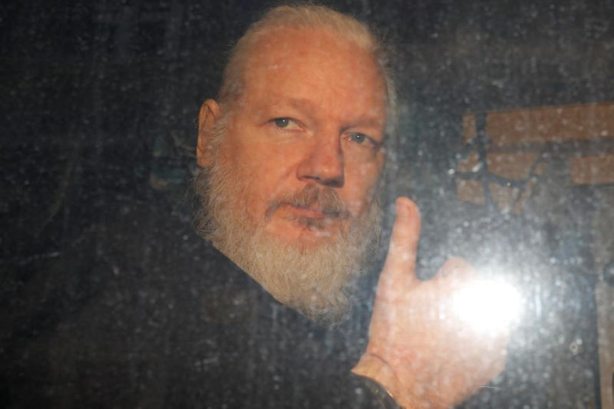 WikiLeaks founder Julian Assange in a police van after being arrested by British police in London, Britain on April 11, 2019.