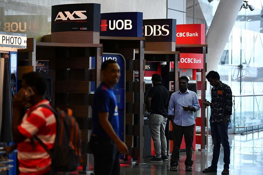 ATMs of banks OCBC, DBS and UOB at the departure hall of Changi Airport Terminal 2, on Feb 15, 2019.
