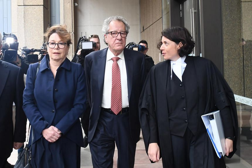Oscar-winner Geoffrey Rush (centre) had sued News Corp's Sydney tabloid over a series of articles that said he was the subject of a complaint to the Sydney Theatre Company regarding a 2015 King Lear production.