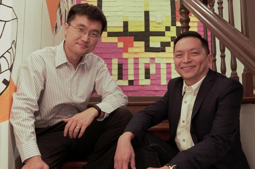 Mr Bill Song, Chief Executive Officer of ZA Tech (left) and Mr Peter Tay, Income's Chief Operating Officer.
