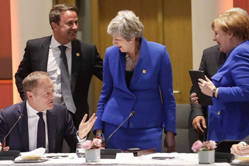 British PM Theresa May (centre), European Council President Donald Tusk (left) and German Chancellor Angela Merkel at the start of a special EU summit on Brexit, on April 10, 2019.