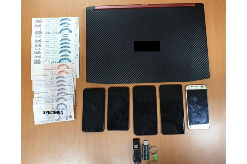 A laptop, five mobile phones, two thumbdrives and about $630 in cash were seized as case exhibits.