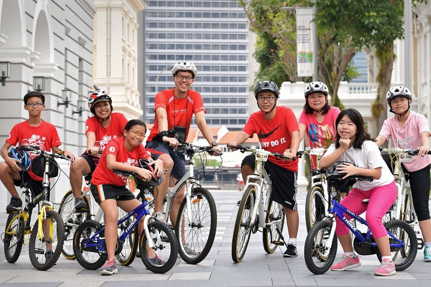 From left: Lee Boon Yee and his mother Mengchoo, sister Boon Xin and father Andy, insurance agents Patrick Teo and Sharon Ong and their daughters Kara and Joley are eagerly awaiting for next month's OCBC Cycle.