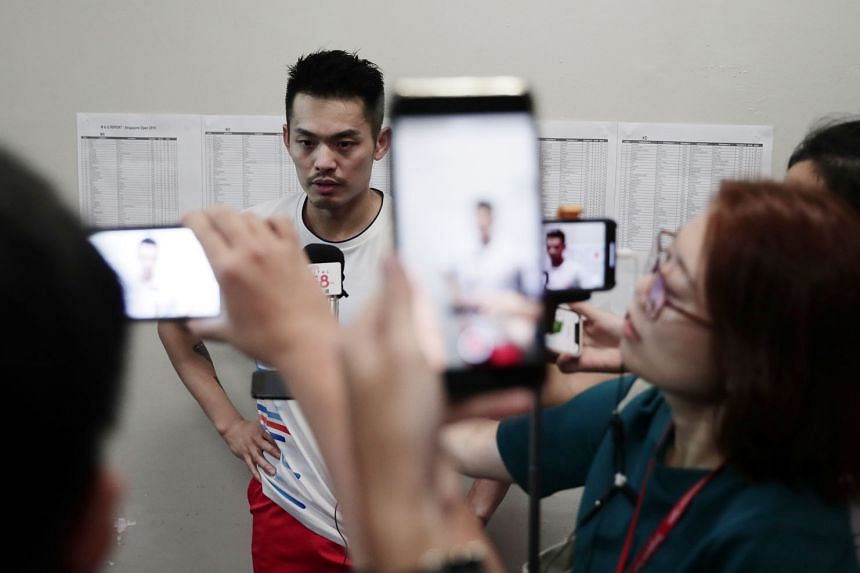 China's Lin Dan talking to journalists at the Singapore Indoor Stadium after he retired in the first game when he was 20-13 down against Dane Viktor Axelsen. He is no stranger to controversy at the Singapore Open - from being a no-show at the pre-tou
