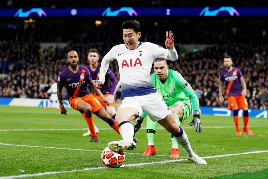 Tottenham forward Son Heung-min keeps the ball in play and beyond the reach of Manchester City goalkeeper Ederson before going on to score the game's only goal.