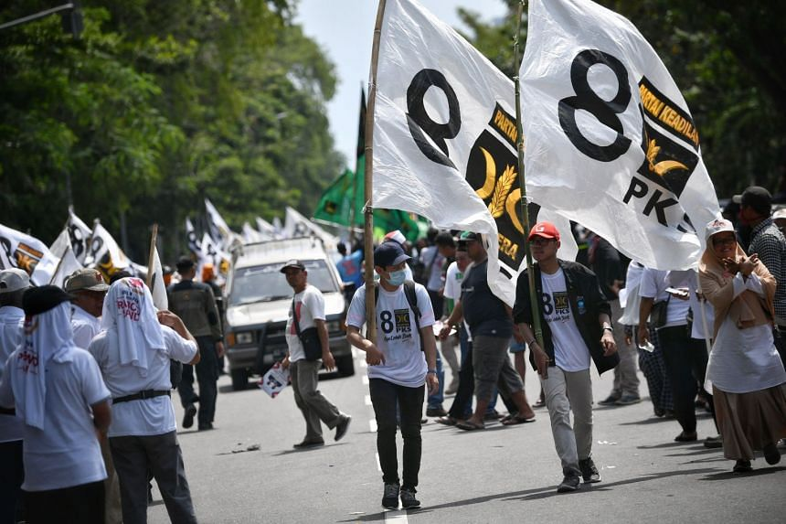 Supporters of the Prosperous Justice Party (PKS) at Mr Prabowo Subianto's rally in Solo, Central Java. According to a survey, the PKS is the only Muslim party likely to secure enough seats to join the House.