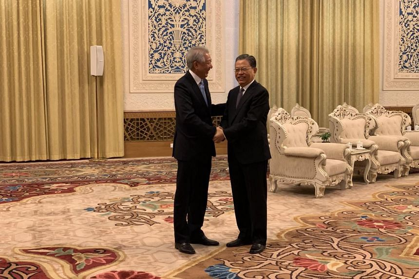 Deputy Prime Minister Teo Chee Hean meeting China's sixth-ranked leader Zhao Leji at the Great Hall of the People in Beijing on April 11, 2019.
