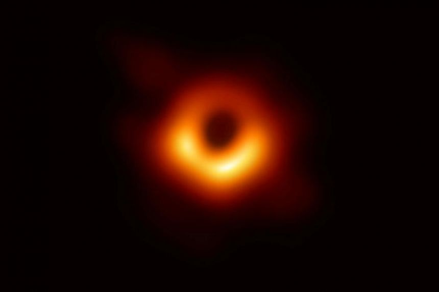 The first ever photo of a black hole, taken using a global network of telescopes, conducted by the Event Horizon Telescope project.