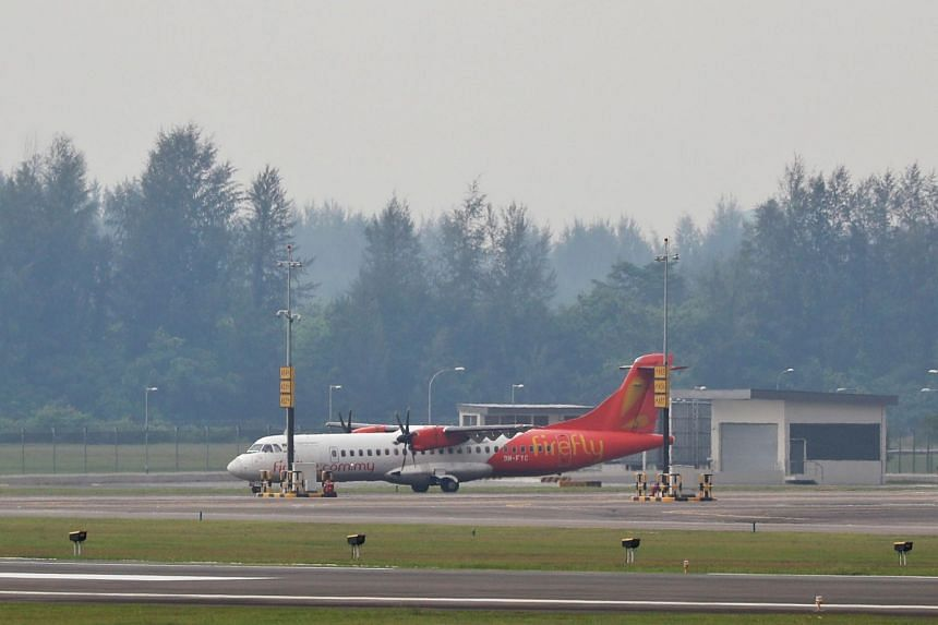 A Firefly aircraft landing for the first time at Seletar Airport on Thursday (April 11).