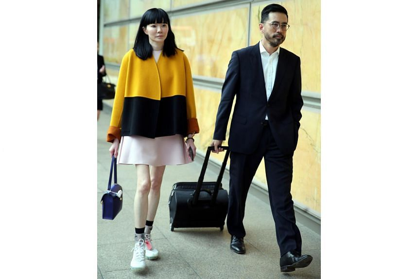 Dr Georgia Lee and her lawyer Chong Yee Leong leaving the court building on April 11, 2019. Dr Lee was testifying in a lawsuit brought against her and three of her companies by a movie and TV producer seeking refund of a $2 million investment.