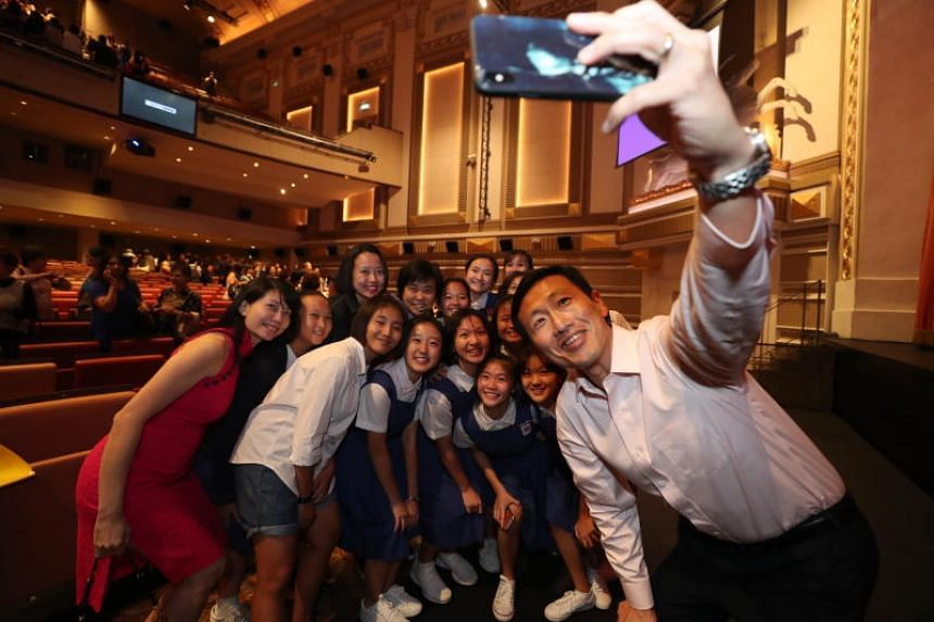 Education Minister Ong Ye Kung with cast members of From Victoria Street to Ang Mo Kio, a documentary-drama that pays tribute to the contributions of former educators from CHIJ St Nicholas Girls' School, during the film's premiere at the Capitol Thea