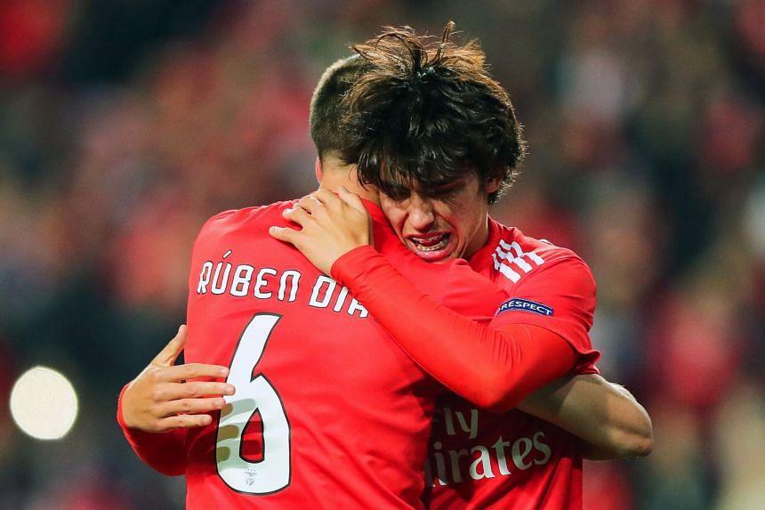Felix (right) celebrates a goal with his team mate Ruben Dias.