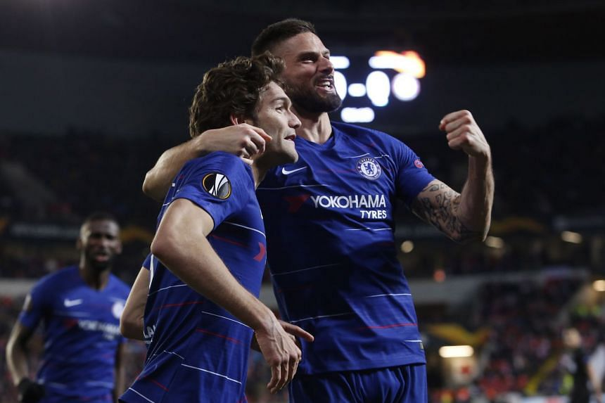 Marcos Alonso (left) and Olivier Giroud of Chelsea celebrate Alonso's goal.