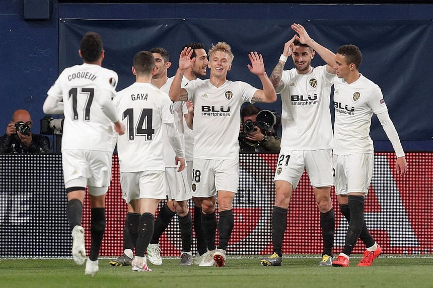 Valencia's winger Daniel Wass (centre) celebrates with his team mates after scoring.