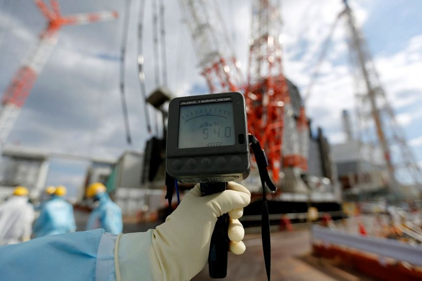 A geiger counter measures radiation levels at the crippled Fukushima Daiichi nuclear power plant, in February 2019.