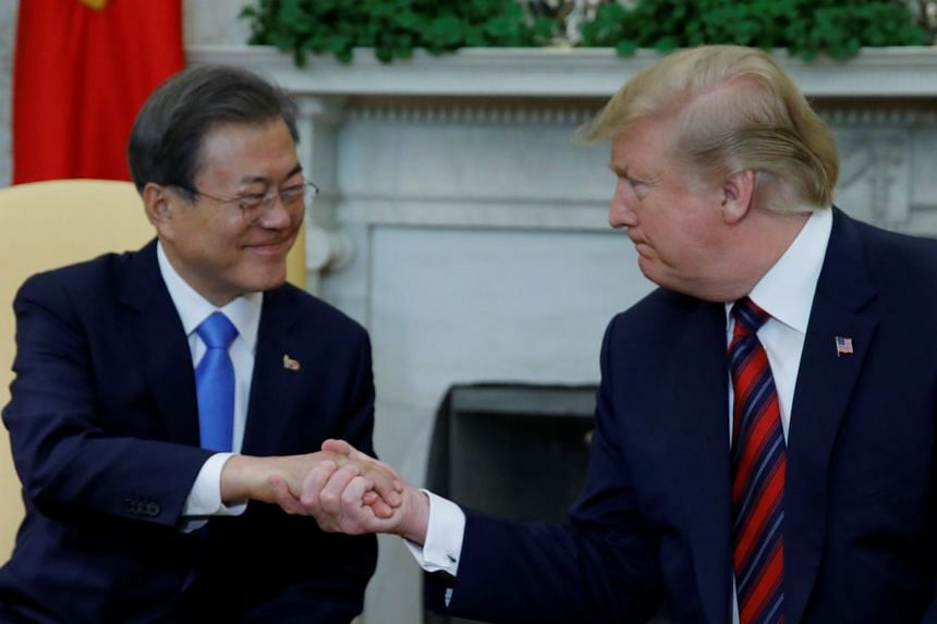 US President Donald Trump greets South Korean President Moon Jae-in in the Oval Office at the White House.