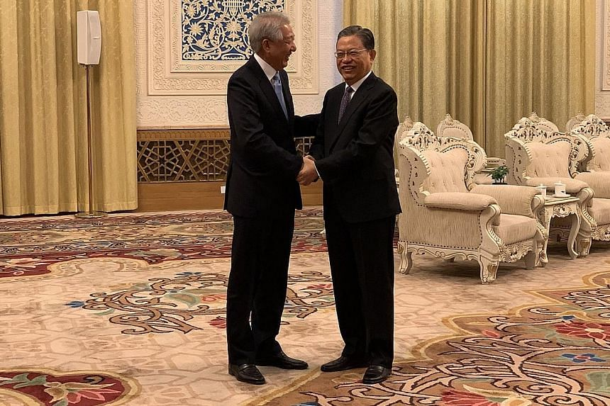 Deputy Prime Minister Teo Chee Hean (far left) meeting China's sixth-ranked leader Zhao Leji yesterday at Beijing's Great Hall of the People. He told Mr Zhao that he has brought a delegation of both familiar and new faces to strengthen bilateral rela