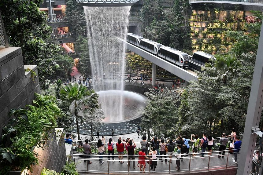 Jewel's highlights include this 40m-tall indoor waterfall, as well as a five-storey garden with over 2,000 trees and palms, and over 100,000 shrubs. From June 10, it will also offer play attractions such as a 50m-long suspended bridge with a glass fl