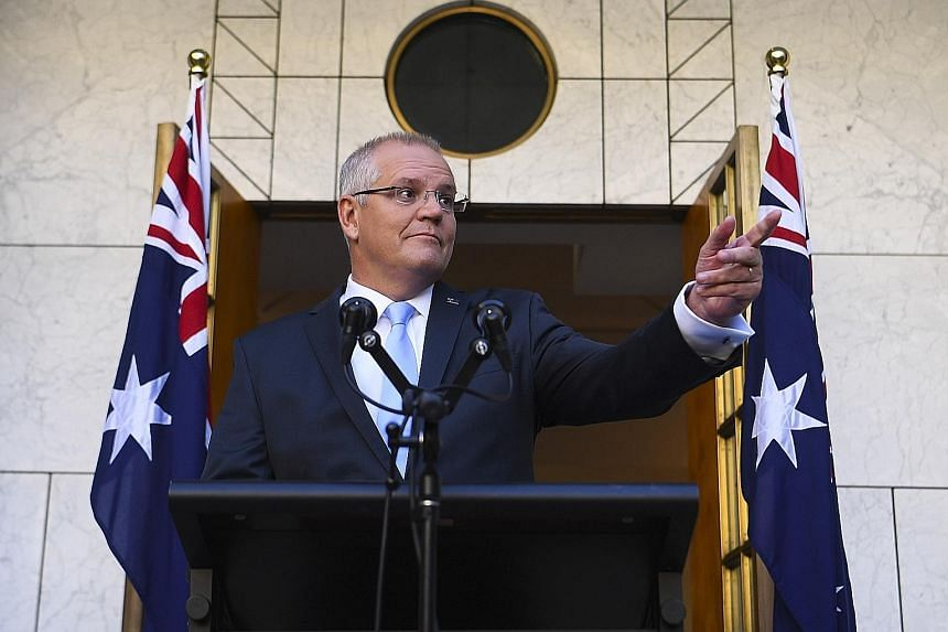 Australian Prime Minister Scott Morrison called the election just a week after delivering a federal budget that promised to return a surplus next year - for the first time in more than a decade. PHOTO: EPA-EFE
