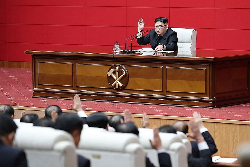North Korean leader Kim Jong Un at the 4th Plenary Meeting of the 7th Central Committee of the Workers' Party of Korea in Pyongyang on Wednesday. PHOTO: AGENCE FRANCE-PRESSE
