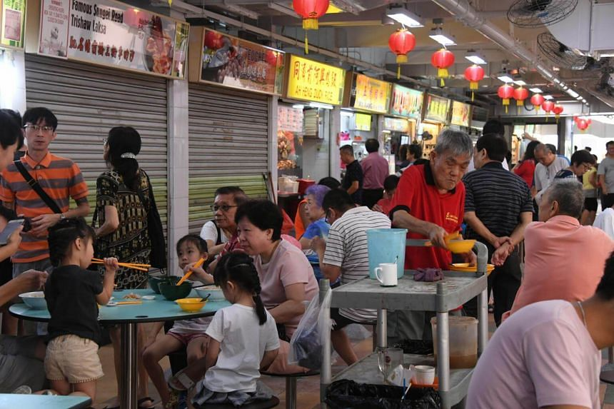 Stalls and patrons at Hong Lim Food Centre in Upper Cross Street.
