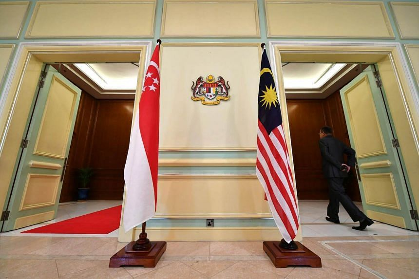 The flags of Singapore (left) and Malaysia at a multi-purpose hall in Perdana Putra Building, Putrajaya, Malaysia, on April 9, 2019.