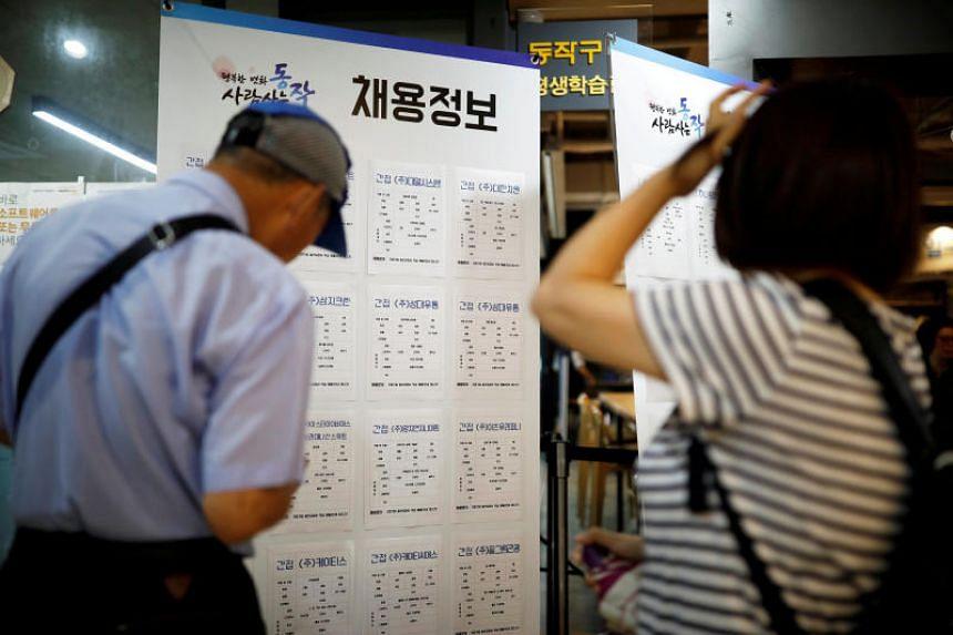 Jobseekers at a local job fair in Seoul, South Korea, on Aug 23, 2018.