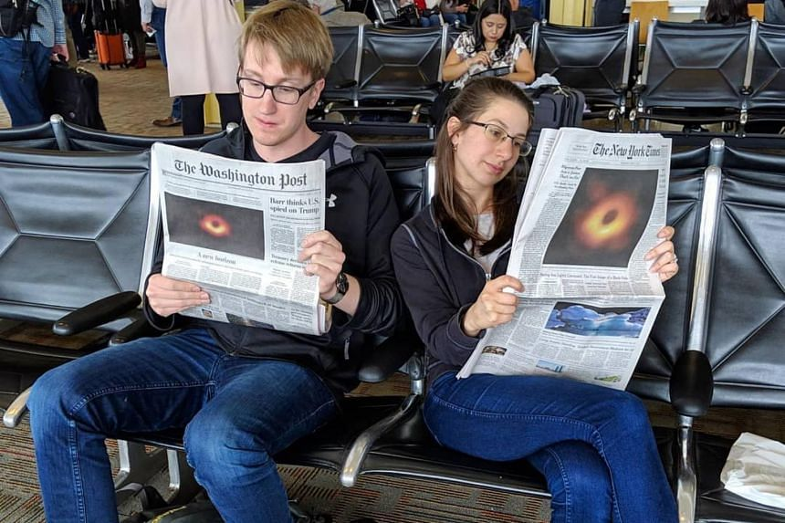 Dr Katherine Bouman, a postdoctoral researcher who developed an algorithm that was key to capturing the image of a black hole, with Mr Andrew Chael, another member of the Event Horizon Telescope team.