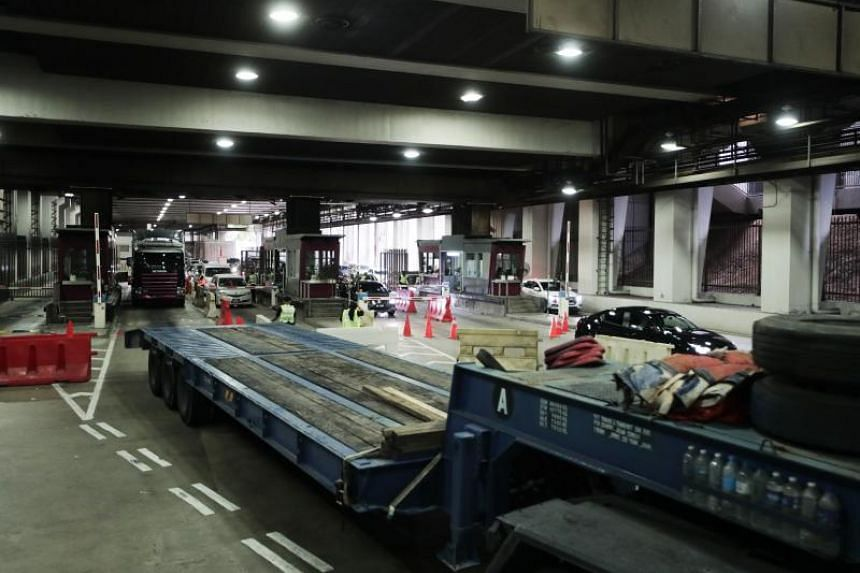 Vehicles clearing customs at the designated zone for heavy vehicles at the Woodlands Checkpoint departure hall on April 12, 2019.