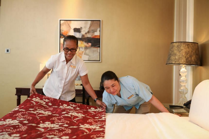 Madam Saadiah Martawi (left) has worked as a housekeeper at Resorts World Sentosa for nine years.