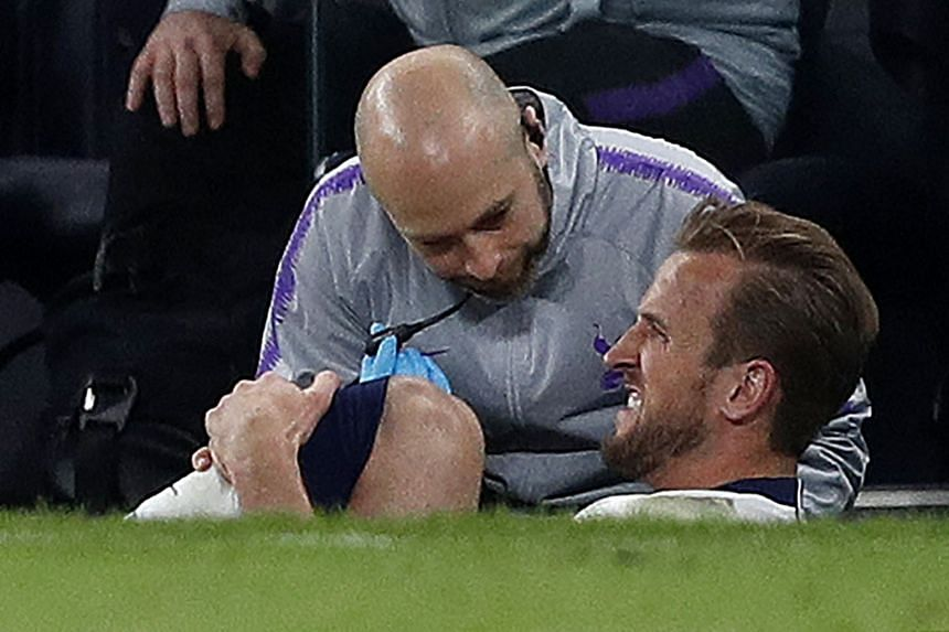 Kane reacts after a tackle on Manchester City's English midfielder Fabian Delph.