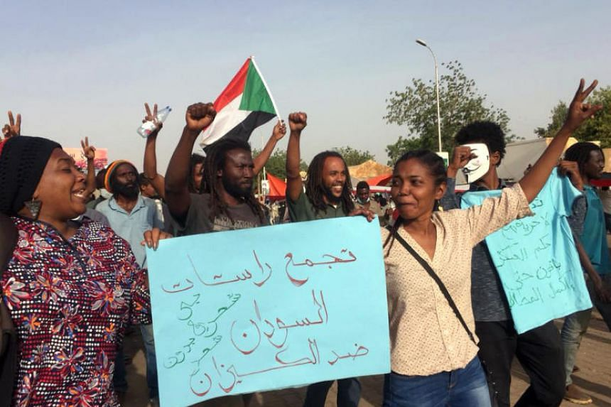 Sudanese protesters gather in the streets of Khartoum as they continue to rally demanding a civilian body to lead the transition to democracy on April 12, 2019.