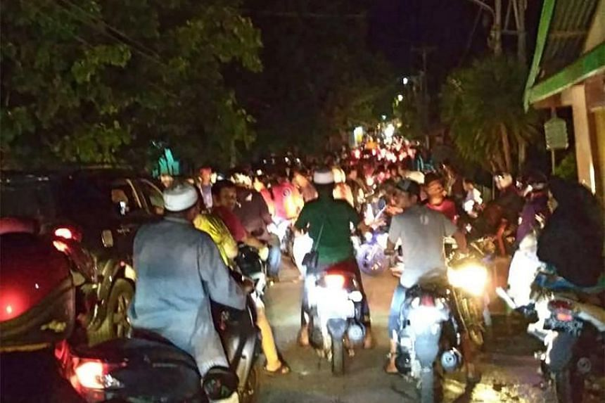 Residents, fearing a tsunami, rushing for higher ground after a strong 6.8-magnitude earthquake rocked Luwuk in Central Sulawesi, Indonesia, on April 12, 2019.