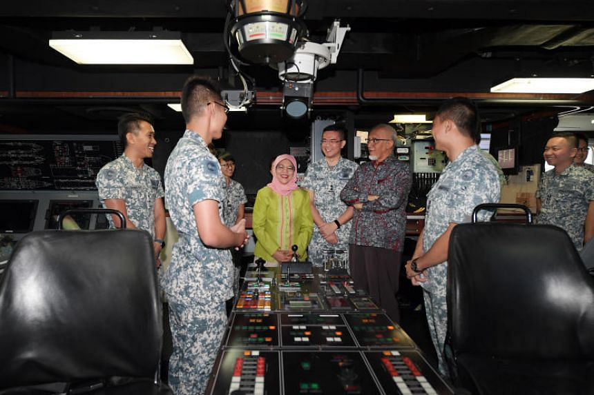 President Halimah Yacob (in green) and Mr. Mohammed Abdullah Alhabshee (third from right) visit the bridge of the Landing Ship Tank RSS Endeavour as part of their tour of the RSS Singapura - Changi Naval Base on April 12, 2019. Accompanying them are