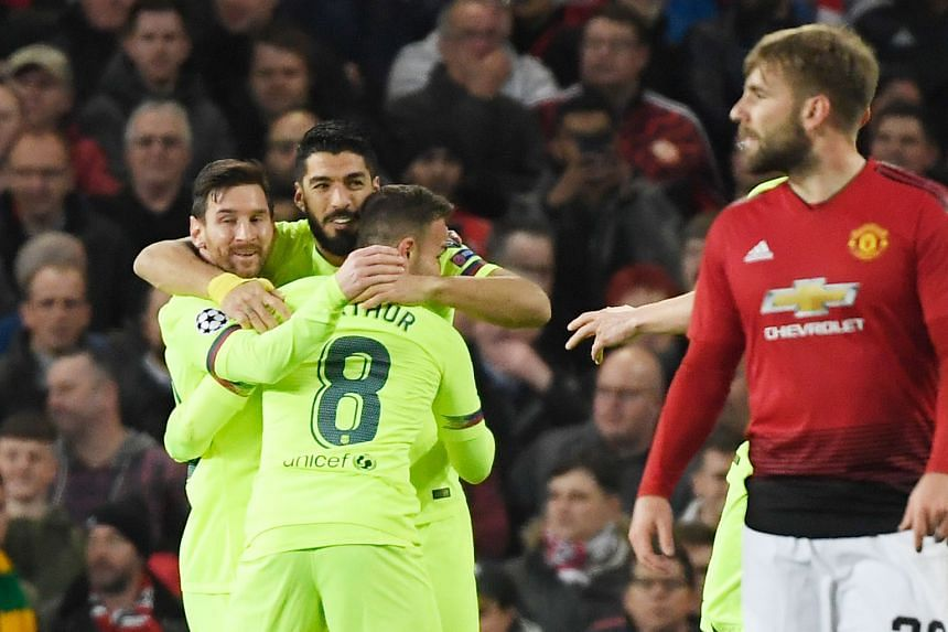 Barcelona striker Luis Suarez celebrating with Lionel Messi (left) and Arthur after an own goal by Luke Shaw gave them a 1-0 first-leg win in their Champions League quarter-final tie against Manchester United at Old Trafford on Wednesday.