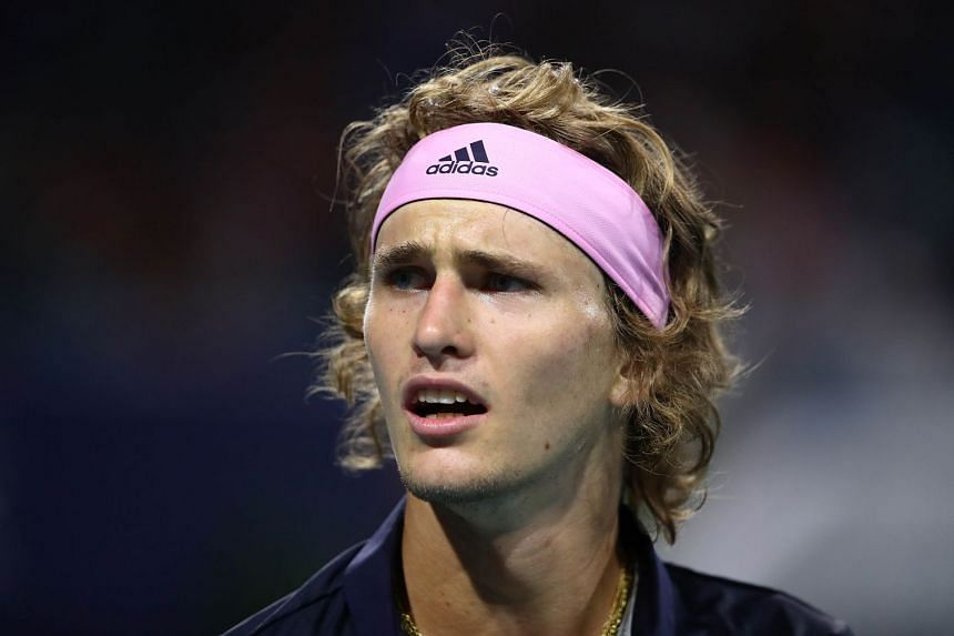 Zverev (above) suffered a 7-6 (7/1), 2-6, 6-3 loss against 60th-ranked Jaume Munar.