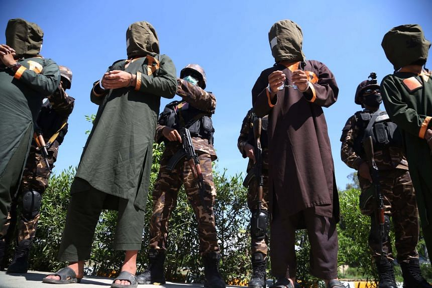 Afghan security officials escort a group of suspected militants in Jalalabad, Afghanistan.