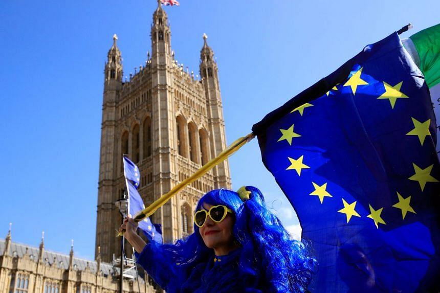 An anti-Brexit protester outside the Houses of Parliament in London..