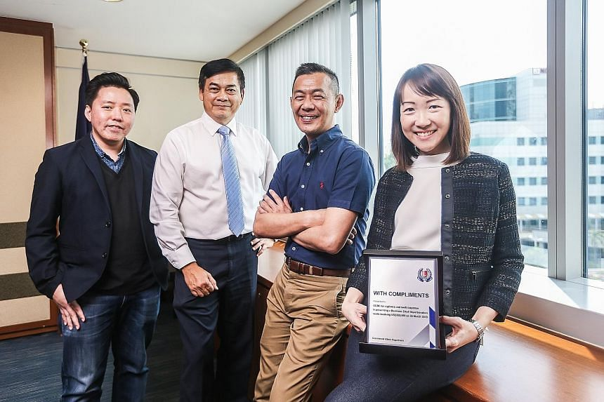 OCBC Bank staff with the Public Spiritedness Award (from left): Mr Royston Soon, assistant vice-president of fraud risk management; Mr Francisco John Celio, head of corporate security; Mr Ridhwan Khoo, head of fraud risk management; and Ms Angeline W