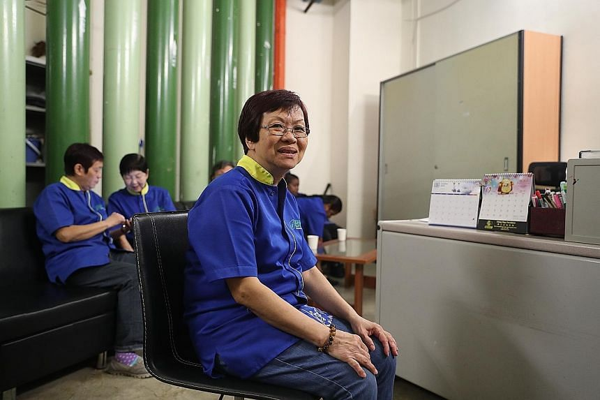AIR-CON COMFORT Madam Lim Kwee Choo, who cleans restrooms and offices in The JTC Summit in Jurong, in an air-conditioned rest area at JTC headquarters where she can sit, relax and chat with her colleagues during her hour-long lunch breaks. The space