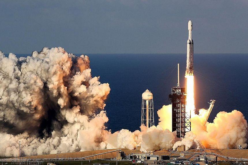 SpaceX's Falcon Heavy rocket launching at the Kennedy Space Centre on Thursday carrying a communications satellite into orbit for Saudi Arabia in the first commercial mission of the world's most powerful rocket.