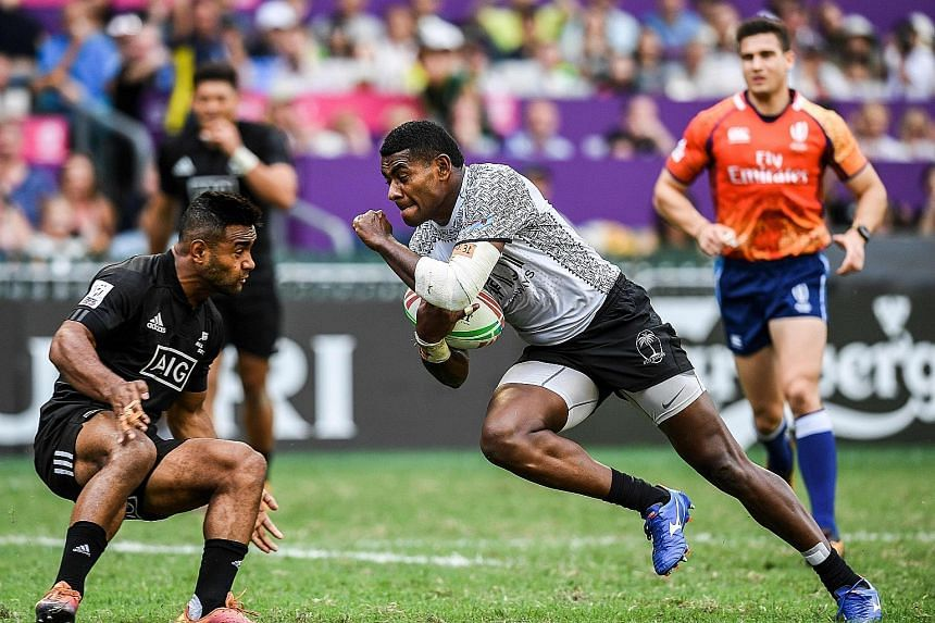 Jona Nareki of New Zealand attempting to stop Apenisa Cakaubalavu in their 24-5 Pool C defeat by Fiji at last weekend's Hong Kong Sevens. The All Blacks Sevens finished sixth, their worst tournament showing in more than a year, and have work to do to