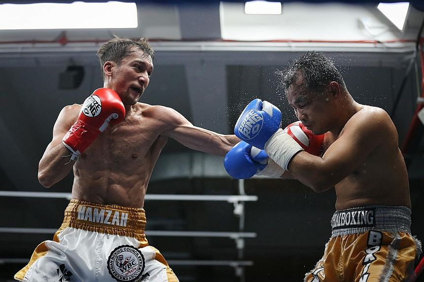 Singaporean Hamzah Farouk finding his range against Paiboon Lorkham during the successful defence of his WBC Asia title.