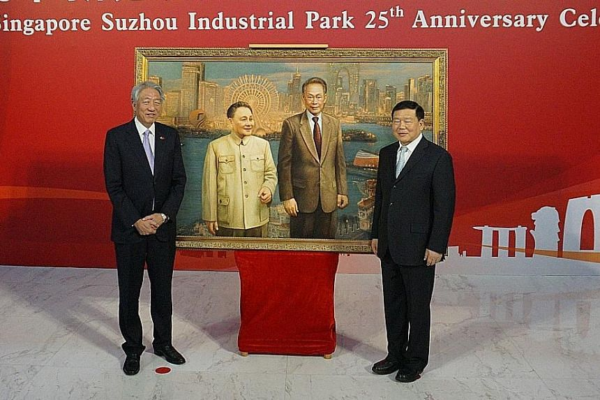 Deputy Prime Minister Teo Chee Hean and Jiangsu party secretary Lou Qinjian launching the China-Singapore Cooperation Gallery to mark the Suzhou Industrial Park's 25th anniversary. Behind them is a silk embroidery by Yao Jianping that replicates a 20