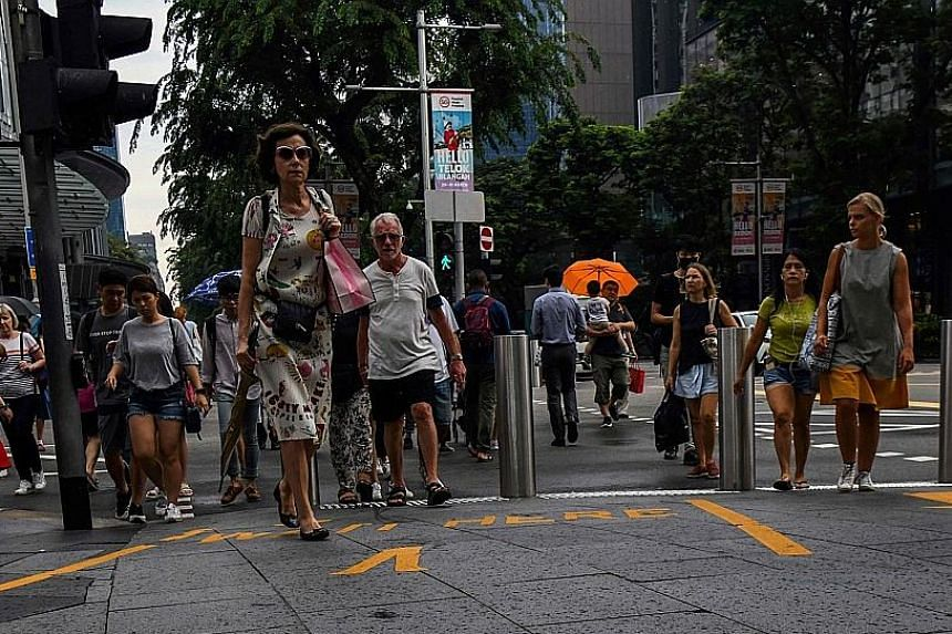 Shoppers at Orchard Road. The estimated total retail sales value in February this year was about $3.3 billion. All segments registered drops in revenue, with food retailers seeing the biggest plunge in sales of 24.8 per cent.