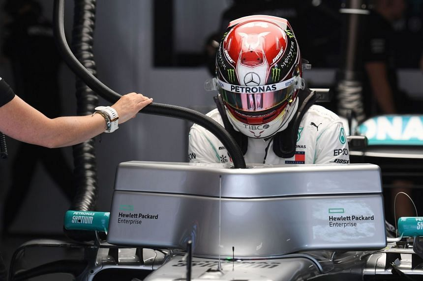 Hamilton gets into his car before the start of the second practice session.